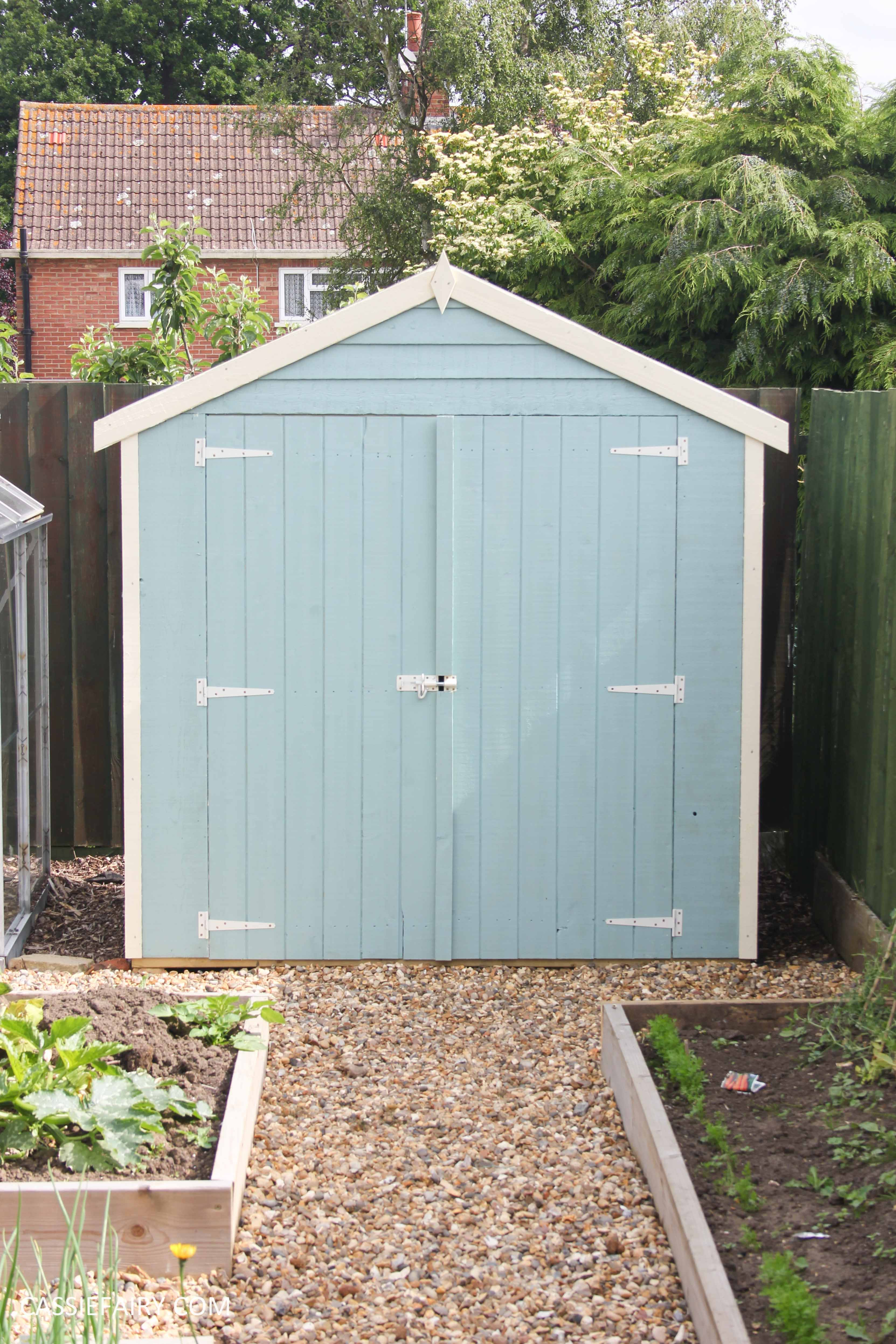 Diy painting and installing small shed duck egg blue for Beach hut ideas